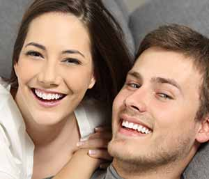 Image of a Young couple smilling with showing their brighter teeth